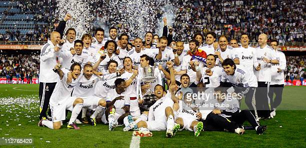 Real Madrid players celebrate with the Copa del Rey trophy after the Copa del Rey Final between Barcelona and Real Madrid at Estadio Mestalla on...