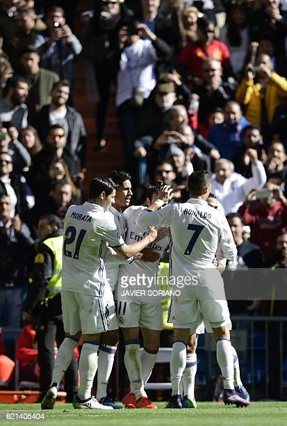Real Madrid players celebrates after scoring a goal during the Spanish league football match Real Madrid CF vs Club Deportivo Leganes SAD at the...