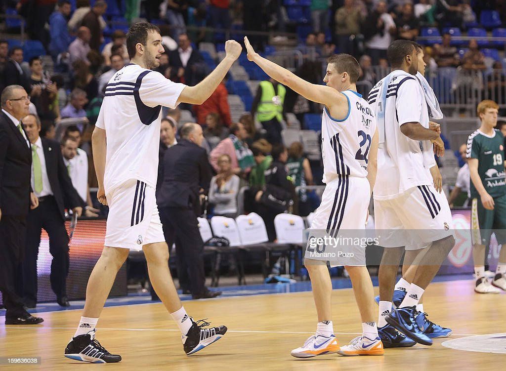 Real Madrid players celebrating victory at the end of the 2012-2013 Turkish Airlines Euroleague Top 16 Date 4 between Unicaja Malaga v Real Madrid at Palacio Deportes Martin Carpena on January 17, 2013 in Malaga, Spain.
