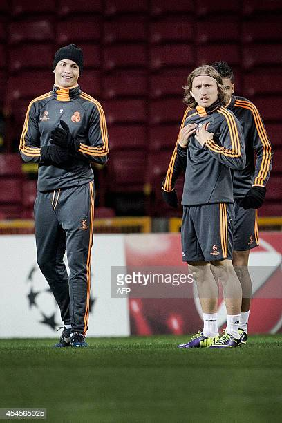 Real Madrid players Cristiano Ronaldo and Luka Modric attend a training session in Parken in Copenhagen on December 9 2013 Real Madrid will face FC...