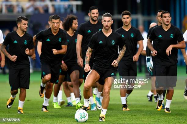 Real Madrid players Cristiano Ronaldo Sergio Ramos and teammates warm up during a training session ahead of the UEFA Super Cup 2017 football match...