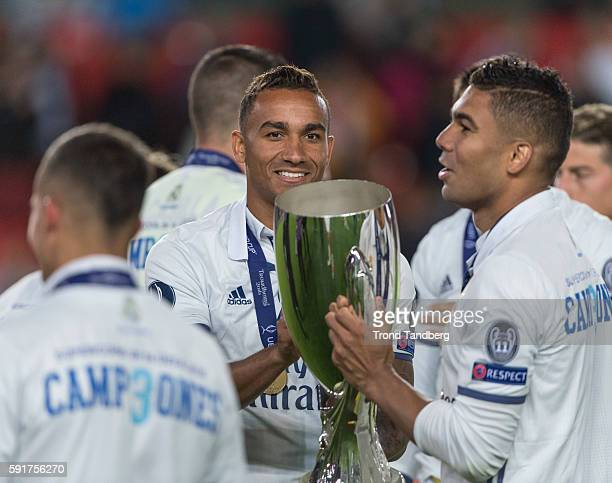 Real Madrid players Danilo Casemiro celebrate with team mates and the trophy after theUEFA Super Cup match between Real Madrid and Sevilla at the...