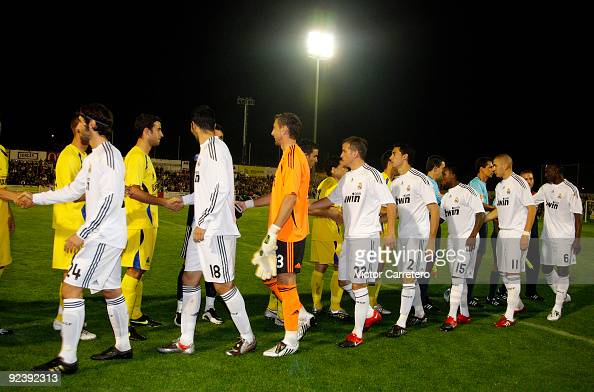 Real Madrid players greet Alcorcon players before the Copa del Rey match between AD Alcorcon and Real Madrid at Municipal de Santo Domingo on October...