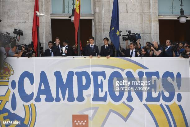 Real Madrid players greet supporters at the Madrid Community headquarters in Madrid on May 22 2017 during a celeration after the team won the Spanish...
