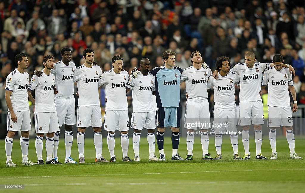 Real Madrid players hold a minute of silence in respect for the victims of the recent earthquake in Japan before the La Liga match between Real Madrid and Hercules at Estadio Santiago Bernabeu on March 12, 2011 in Madrid, Spain.