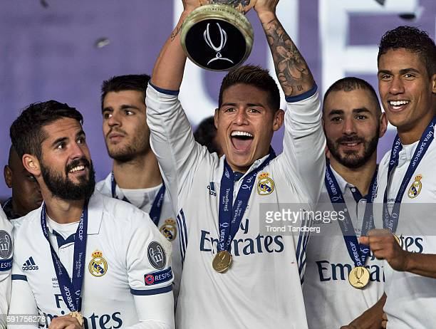 Real Madrid players James Rodriguez Isco Alvaro Morata Karim Benzema Raphael Varane celebrate with team mates and the trophy after theUEFA Super Cup...