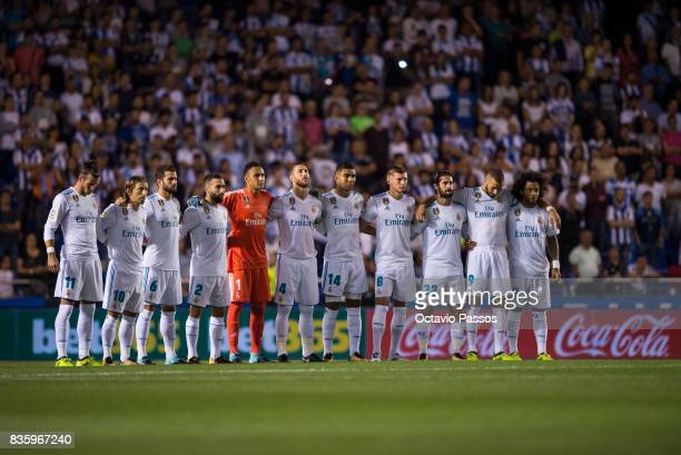 Real Madrid players line up to observe a minute's silence in memory of victims of the terrorist attack in Barcelona this week during the La Liga...