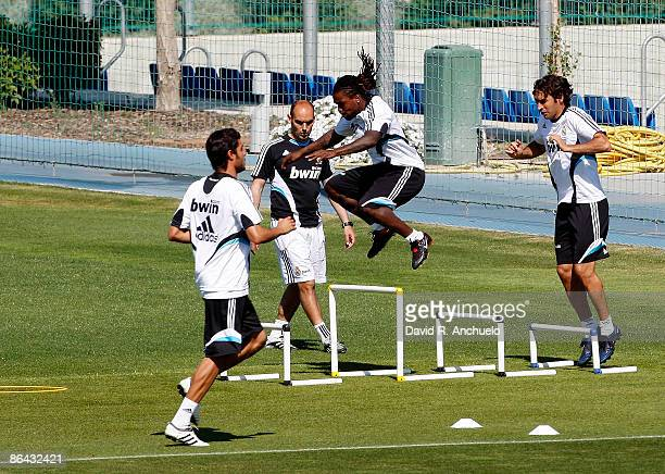 Real Madrid players Miguel Torres Royston Drenthe and Raul Gonzalez in action during a training session at Valdebebas on May 6 2009 in Madrid Spain