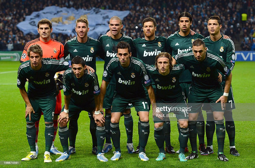 Real Madrid players pose for a team photo before their UEFA Champions League Group D football match against Manchester City at The Etihad Stadium in Manchester, north-west England, on November 21, 2012.