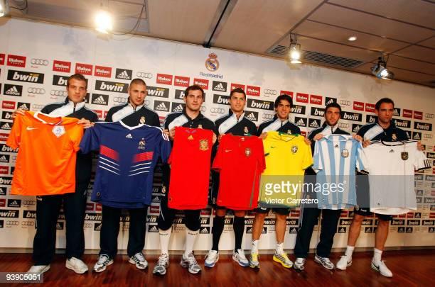Real Madrid players Rafael Van der Vaart Karim Benzema Cristiano Ronaldo Iker Casillas Kaka Gonzalo Higuain and Christoph Metzelder poses after the...