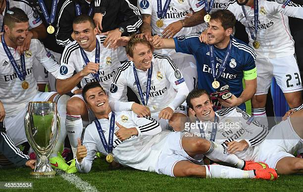 Real Madrid players Ronaldo and Gareth Bale celebrate with team mates and the trophy after the UEFA Super Cup match between Real Madrid and Sevilla...