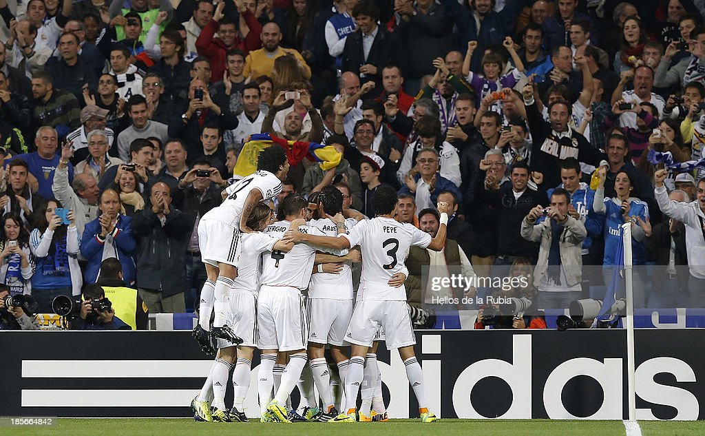 Real Madrid players teammate after scoring during the UEFA Champions League Group B match between Real Madrid and Juventus at Estadio Santiago Bernabeu on October 23, 2013 in Madrid, Spain.