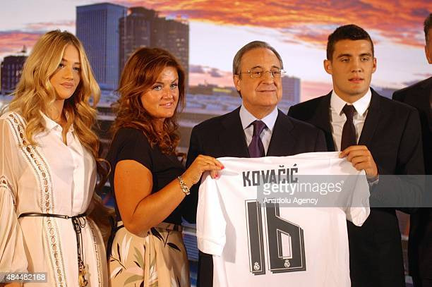 Real Madrid president Florentino Perez Mateo Kovacic Izabel Andrijanic and Kovacic's mother pose during the presentation of Real Madrid's new player...
