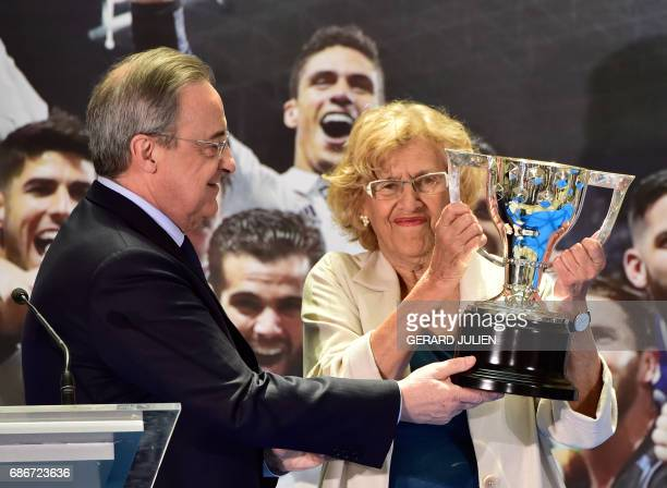 Real Madrid President Florentino Perez presents a replica of the trophy to Mayor of Madrid Manuela Carmena at the Madrid Town hall on Plaza Cibeles...