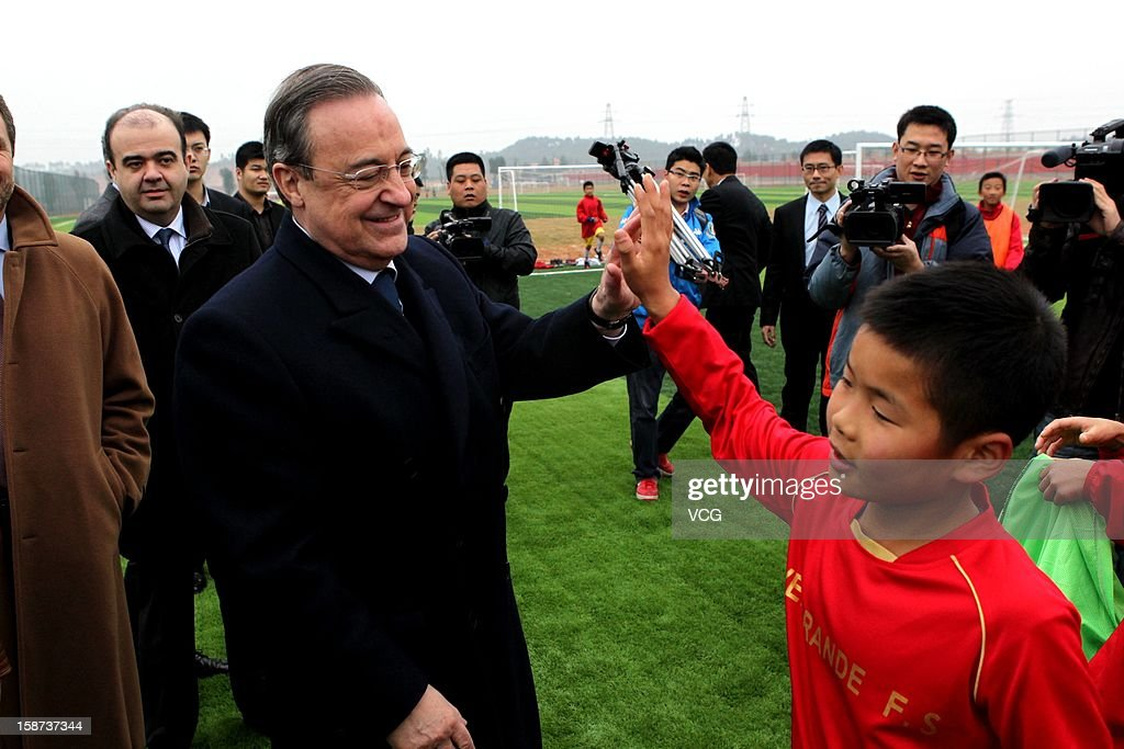 Real Madrid president Florentino Perez visits Evergrande-Real Madrid Football School on December 27, 2012 in Qingyuan, China. Florentino Perez and his delegation are on a multi-day visit to Guangzhou Evergrande FC, who has a cooperation agreement with Real Madrid that has led to the creation of a football school in Qingyuan.