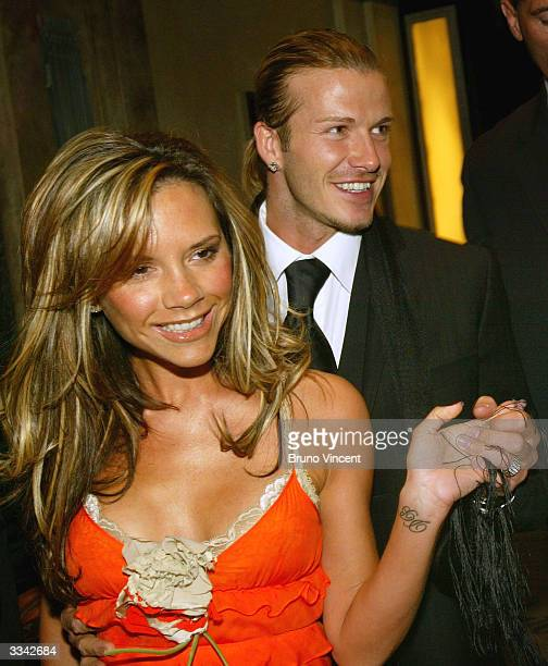 Real Madrid soccer player David Beckham and his wife Victoria Beckham leave Claridges Hotel April 12 2004 in London England