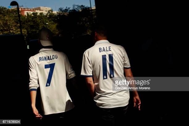 Real Madrid supporters make their way to the stadium prior to the La Liga match between Real Madrid CF and FC Barcelona at Estadio Bernabeu on April...