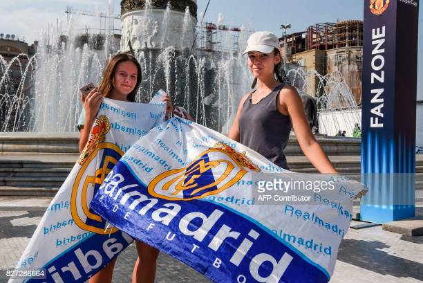 Real Madrid supporters pose with their team's flags at the UEFA Super Cup fan zone in Skopje on August 7 on the eve of the UEFA Super Cup match...