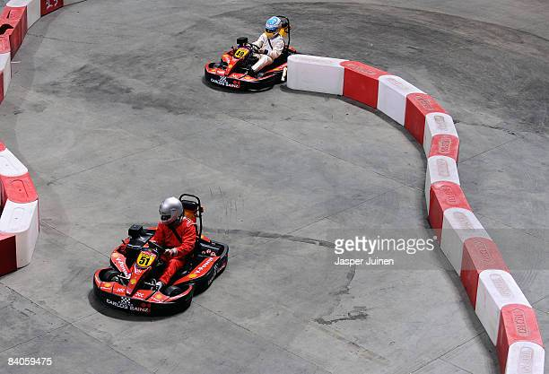Real Madrid team captain Raul Gonzalez rounds a curve in a kart ahead of Formula one driver Fernando Alonso during the 'Iker Vs Rafa' charity game at...