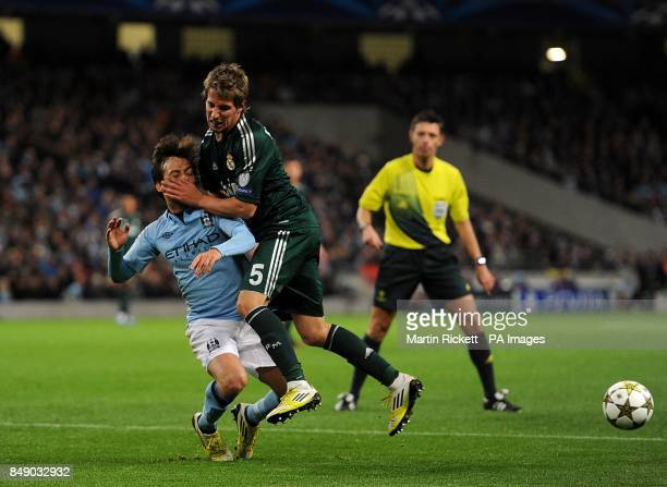 Real Madrid's Alexandre Fabio Coentrao collides Manchester City's David Silva