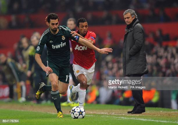 Real Madrid's Alvaro Arbeloa and Manchester United's Luis Nani battle for the ball