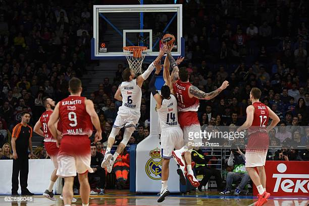 Real Madrid's Andres Nocioni and Gustavo Ayón compete with Miroslav Raduljica of EA7 Emporio Armani Milano during the Euroleague basketball match...