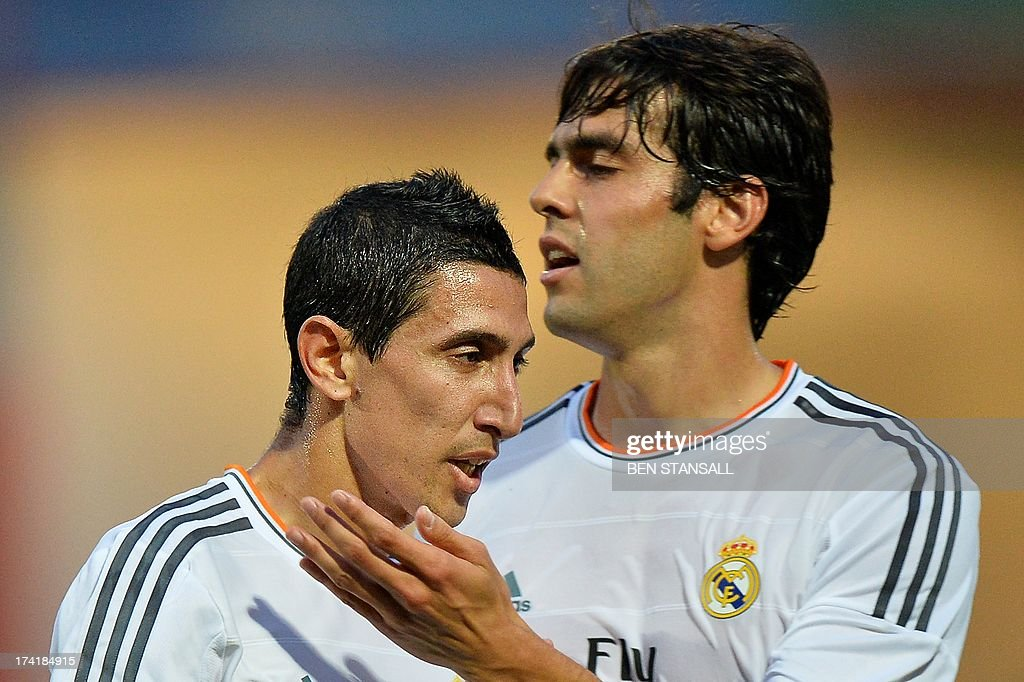 Real Madrid's Angel Di Maria (R) celebrates with Real Madrid's Kaka (R) after scoring a goal during the pre-season friendly football match between Bournemouth and Real Madrid at the Goldsands Stadium in Bournemouth, England on July 21, 2013. AFP PHOTO/BEN STANSALL