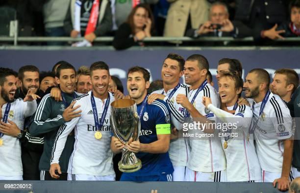 Real Madrid's Angel di Maria Sergio Ramos Iker Casillas Cristiano Ronaldo Pepe Luka Modric and Karim Benzema celebrate after winning the UEFA Super...