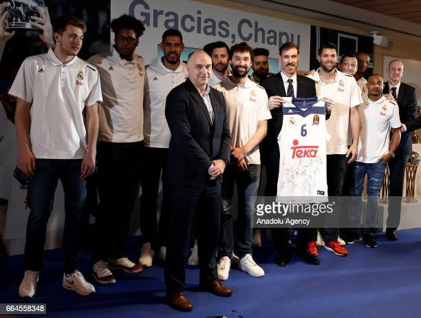 Real Madrid's Argentinian forward Andres Nocioni and Head coach of Real Madrid Pablo Laso pose for a photo during a press conference organised by the...