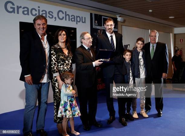 Real Madrid's Argentinian forward Andres Nocioni and Real Madrid's president Florentino Perez pose for a photo during a press conference organised by...