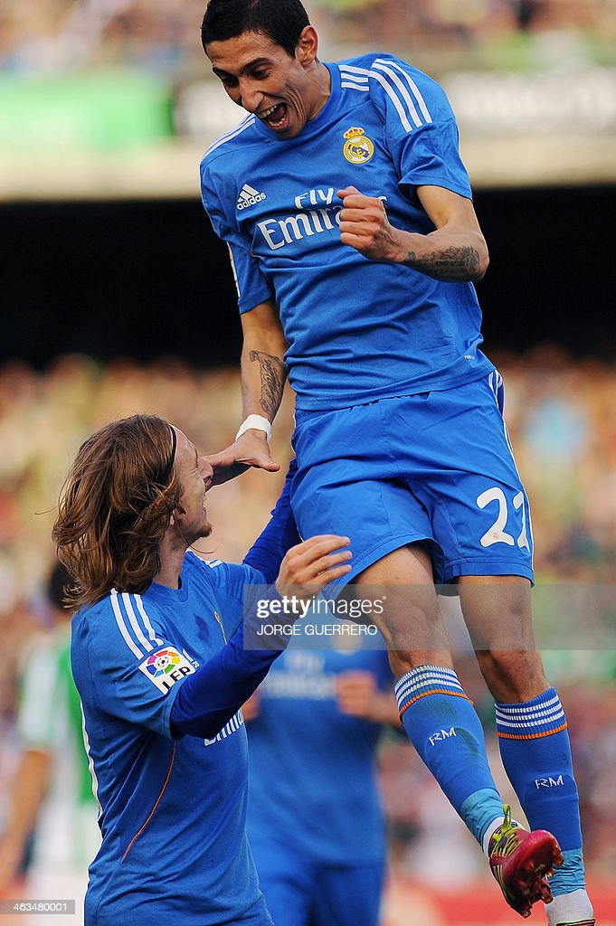 Real Madrid's Argentinian midfielder Angel di Maria (R) celebrates with Croatian midfielder Luka Modric after scoring during the Spanish league football match Real Betis vs Real Madrid on January 18, 2014 at the Benito Villamarin stadium in Sevilla.