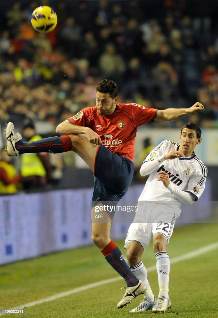 Real Madrid's Argentinian midfielder Angel di Maria (R) vies with Osasuna's defender Damia Abella (L) during the Spanish league football match CA Osasuna vs Real Madrid CF at the Reyno de Navarra stadium in Pamplona on January 12, 2013.