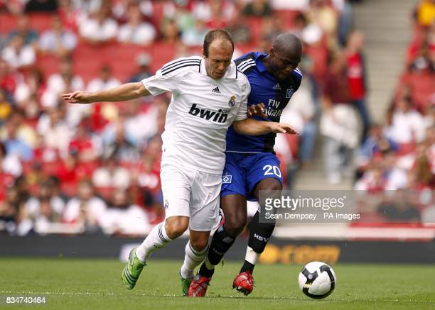 Real Madrid's Arjen Robben and Hamburg's Guy Demel