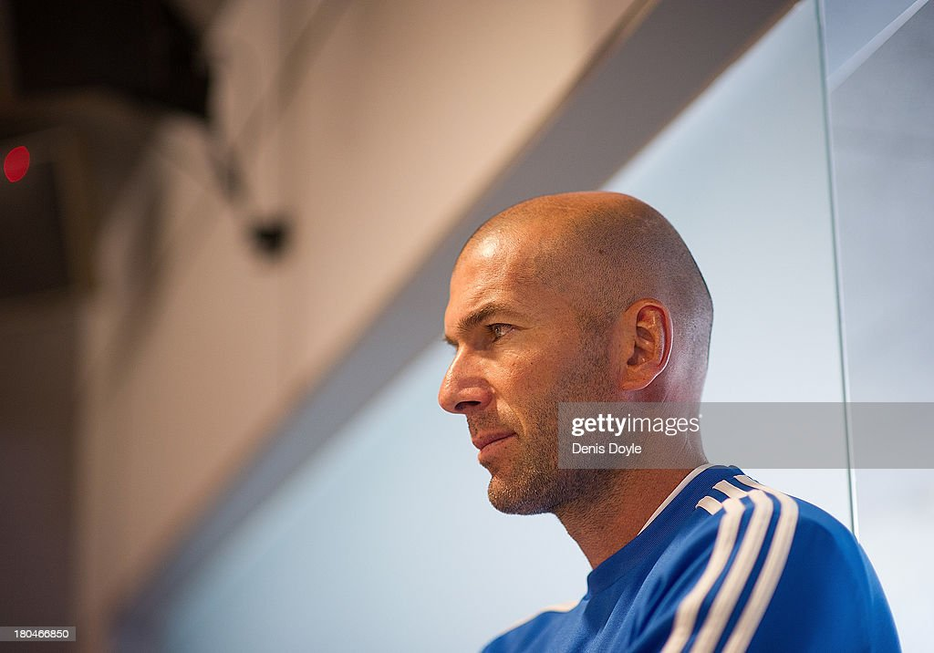 Real Madrid's assistant coach <a gi-track='captionPersonalityLinkClicked' href=/galleries/search?phrase=Zinedine+Zidane&family=editorial&specificpeople=172012 ng-click='$event.stopPropagation()'>Zinedine Zidane</a> looks on after a team training session on September 13, 2013 in Madrid, Spain.