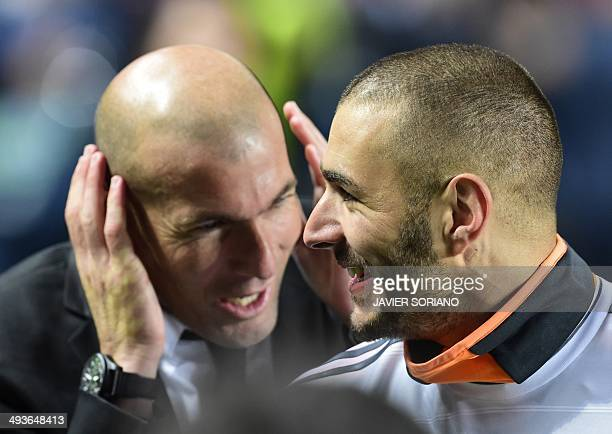 Real Madrid's assistant manager Zinedine Zidane and Real Madrid's French forward Karim Benzema celebrate their victory at the end of the UEFA...