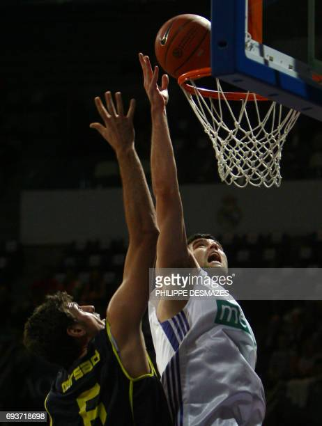 Real Madrid's Blagota Sekulic vies with Fenerbache's Mirsad Turcan during their Euroleague basketball match at the Vista Alegre stadium in Madrid 13...
