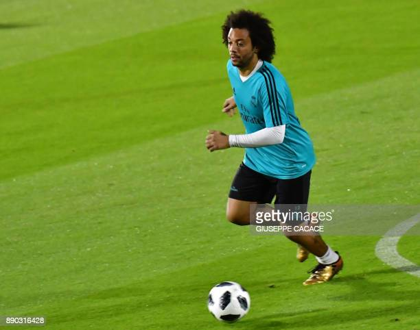 Real Madrid's Brasilian defender Marcelo dribbles the ball during a training session two days prior to his team's FIFA Club World Cup semifinal match...