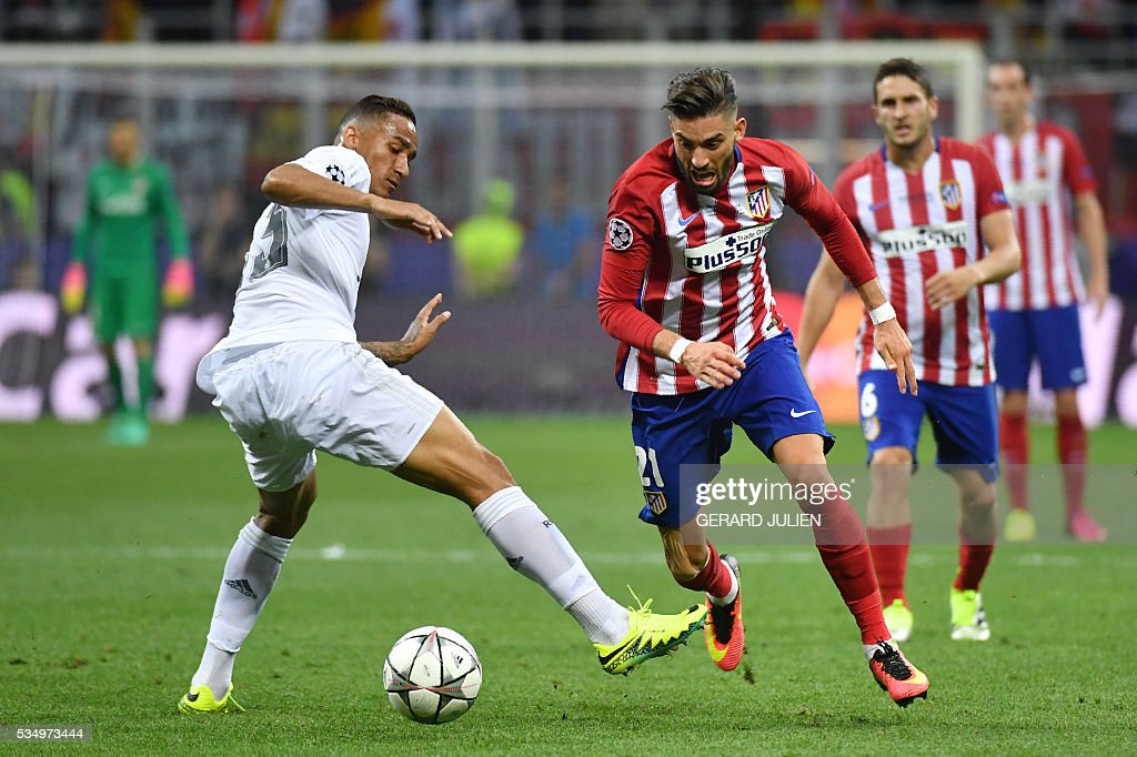 Real Madrid's Brazilian defender Danilo (L) and Atletico Madrid's Belgian forward Yannick Ferreira Carrasco fight for the ball during the UEFA Champions League final football match between Real Madrid and Atletico Madrid at San Siro Stadium in Milan, on May 28, 2016. / AFP / GERARD