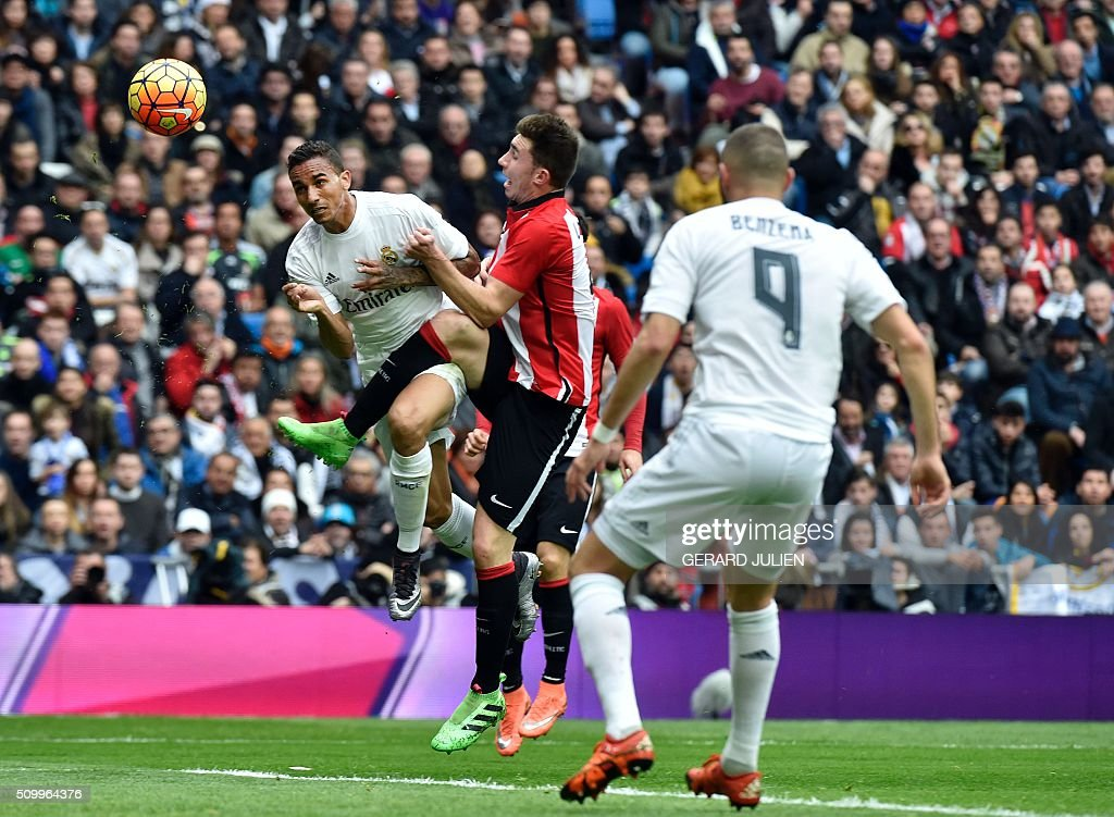 Real Madrid's Brazilian defender Danilo (L) heads the ball during the Spanish league football match Real Madrid CF vs Athletic Club Bilbao at the Santiago Bernabeu stadium in Madrid on February 13, 2016. / AFP / GERARD JULIEN