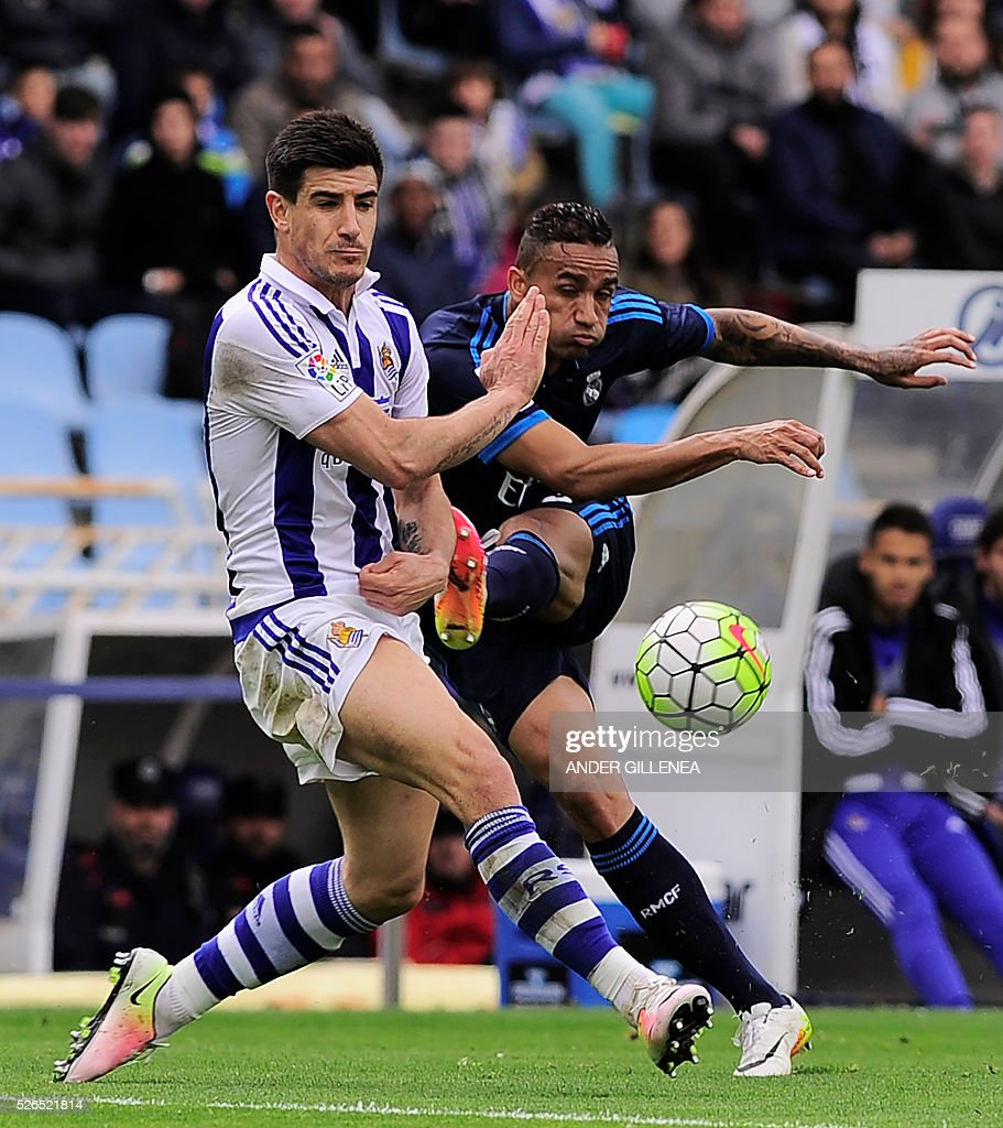 Real Madrid's Brazilian defender Danilo Luiz Da Silva (R) vies with Real Sociedad's defender Yuri Berchiche during the Spanish league football match Real Sociedad vs Real Real Madrid CF at the Anoeta stadium in San Sebastian on April 30, 2016. / AFP / ANDER