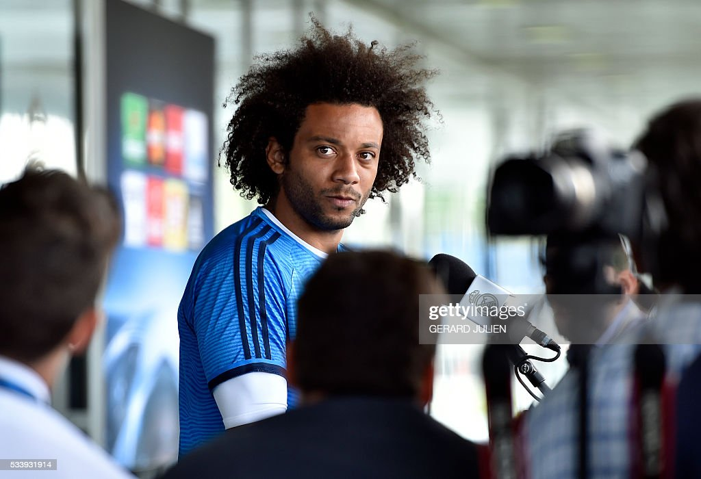 Real Madrid's Brazilian defender Marcelo addresses journalists during the club's Open Media Day at Real Madrid sport city in Madrid on May 24, 2016. / AFP / GERARD
