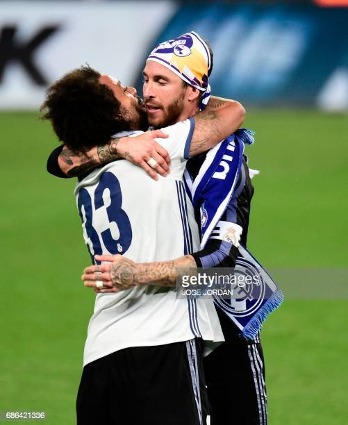 Real Madrid's Brazilian defender Marcelo and Real Madrid's defender Sergio Ramos celebrate winning the Liga title after the Spanish league football...