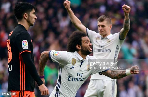 TOPSHOT Real Madrid's Brazilian defender Marcelo celebrates a goal during the Spanish league football match Real Madrid CF vs Valencia CF at the...