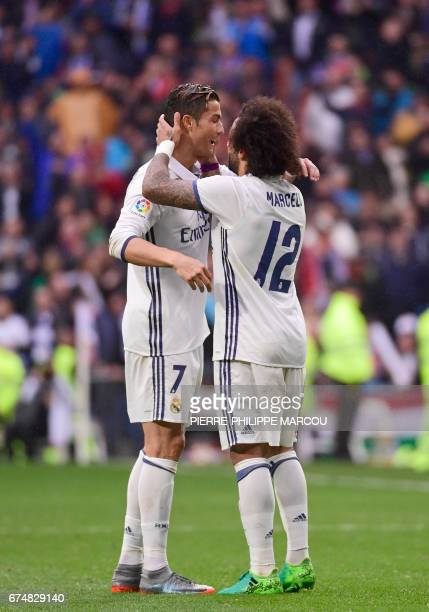 Real Madrid's Brazilian defender Marcelo celebrates a goal with Real Madrid's Portuguese forward Cristiano Ronaldo during the Spanish league football...