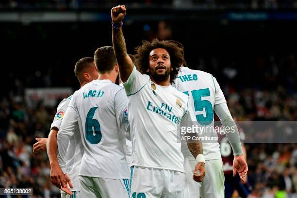 Real Madrid's Brazilian defender Marcelo celebrates after scoring his team's third goal during the Spanish league football match Real Madrid CF vs SD...