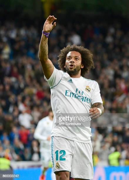 Real Madrid's Brazilian defender Marcelo celebrates after scoring during the Spanish league football match Real Madrid CF vs SD Eibar at the Santiago...