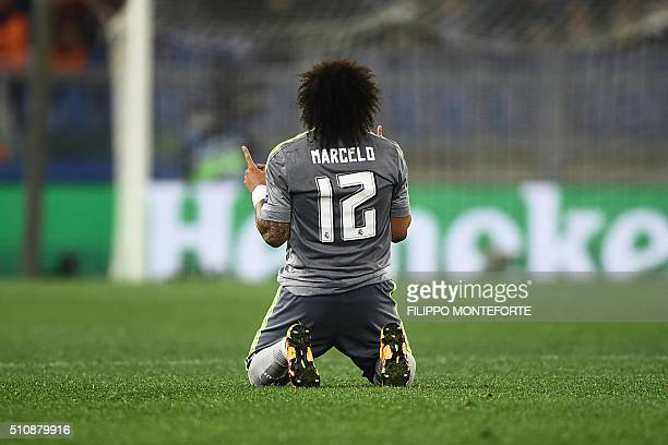 Real Madrid's Brazilian defender Marcelo celebrates at the end of the UEFA Champions League football match AS Roma vs Real Madrid on Frebruary 17...