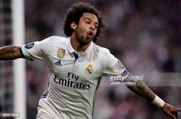 Real Madrid's Brazilian defender Marcelo celebrates at the end of the UEFA Champions League quarterfinal second leg football match Real Madrid vs FC...