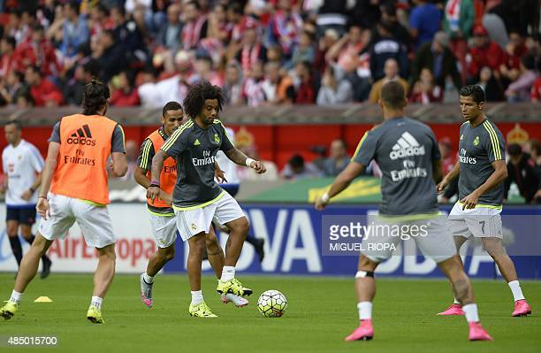 Real Madrid's Brazilian defender Marcelo controls the ball as he trains before the start of the Spanish league football match Sporting Gijon vs Real...
