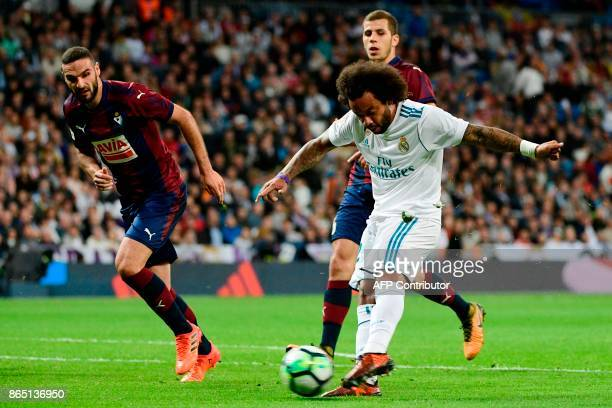 Real Madrid's Brazilian defender Marcelo kicks the ball to score his team's third goal during the Spanish league football match Real Madrid CF vs SD...